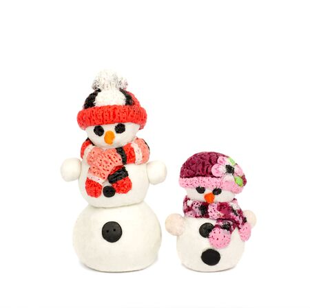 modeling: Hand made plasticine or modeling clay figure of snowman on white background.Christmas decoration