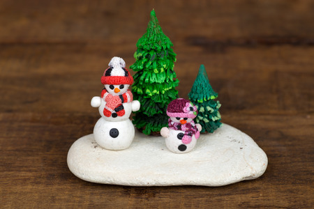 clay modeling: Hand made plasticine or modeling clay figure of snowman and Christmas tree.Christmas decoration