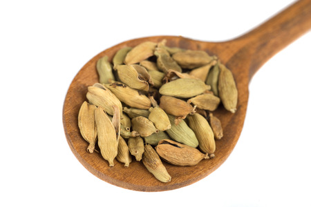 Dried cardamom spice on wooden spoon  isolated on white background Stock fotó - 99190423