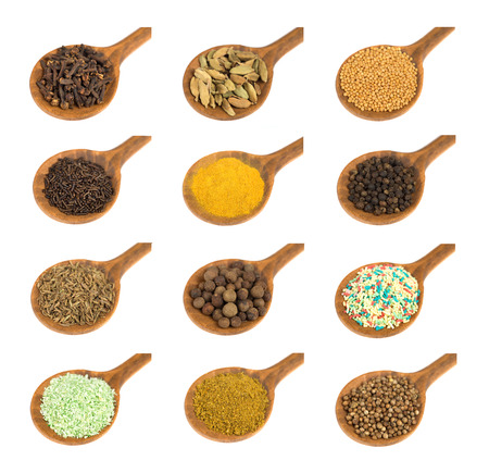 Set or collection of different spices and seeds  on wooden spoon  isolated on white background  Stockfoto