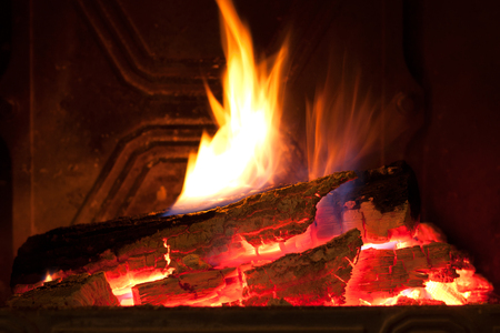 Close image of fire in the fireplace Stock fotó - 99445458