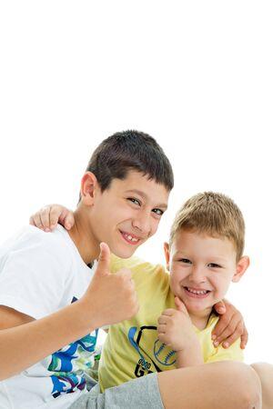 Two happy joyful and loving  brothers isolated on white background.