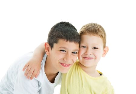 Two happy joyful and loving  brothers isolated on white background.Smiling at camera.