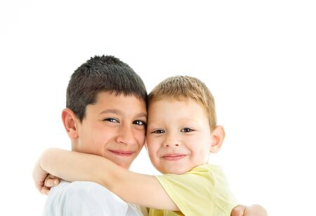 Two happy joyful and loving  brothers isolated on white background.Smiling at camera.Four years and nine years old Stock fotó - 127438173