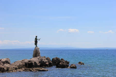 Statue of woman holding seagull. Opatija, Croatia