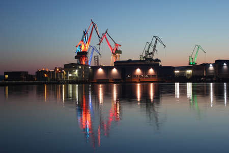 Iluminated cranes at shipyard. Pula, Croatia.