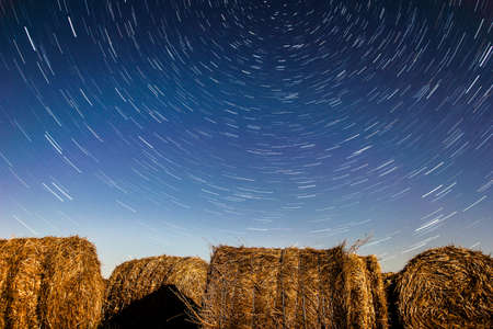 Dreamy startrails above hay bales