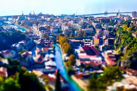 Aerial view on city RIjeka over rooftops, Croatia Europe. Tilt shift miniature effect Stock Photo