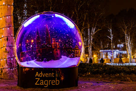 Zagreb, Croatia: 14th December 2018  Decorated snow ball in Zrinjevac park, Zagreb Advent Best Christmas market in Europe Editorial