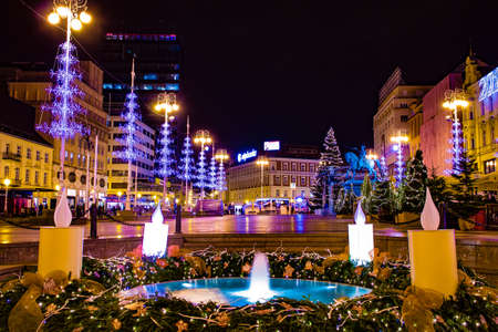 Zagreb, Croatia: 14th December 2018 / Decorated Trg bana Jelacica square and Mandusevac Fountain in Zagreb Advent Best Christmas market in Europe