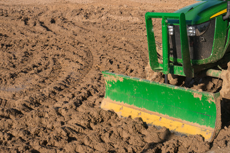 ploughing field: Tractor ploughing a field