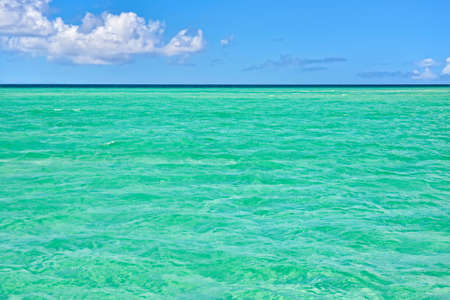 azul turqueza: Tropical sea with turquoise water, blue sky and white clouds. Caribbean Sea, Dominican Republic.