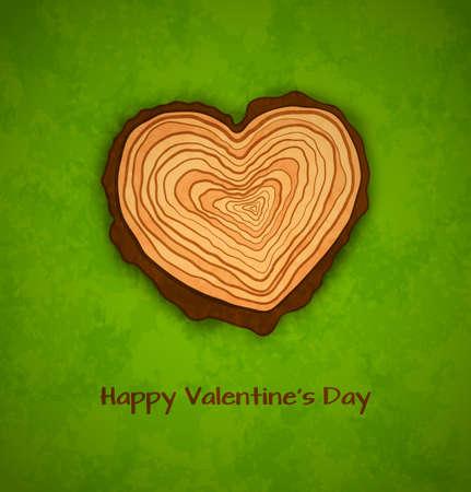 cruz de madera: Secci�n transversal de madera de la forma del coraz�n en fondo verde.