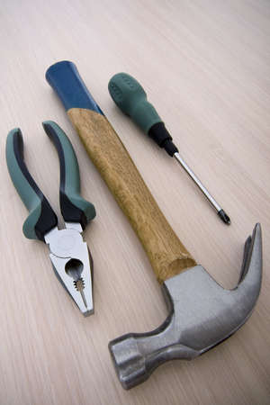 flatnose: Hammer, flat-nose pliers and screw-driver