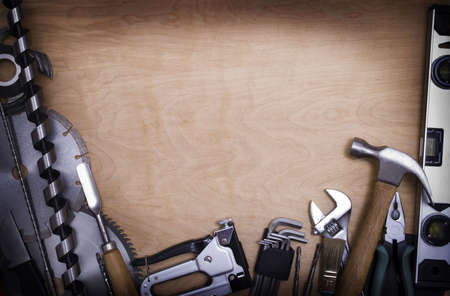 Tools on a wooden background Stock Photo - 5063265