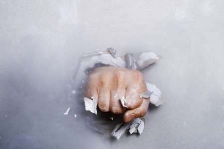 intolerant: The fist has punched wall, than has created the torn hole