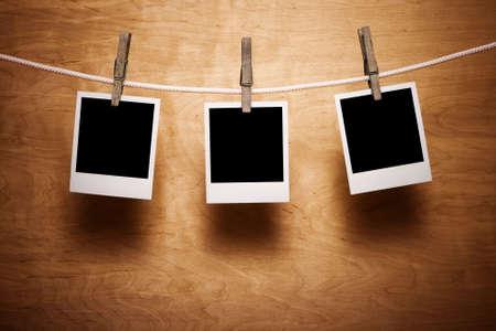 album photo: Polaroids on a wooden background Stock Photo