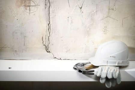 Building helmet, protective gloves, hammer, adjustable spanner.Building background photo