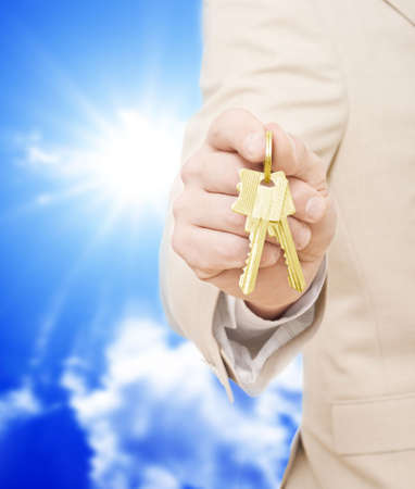 in escrow: Handing over the keys.Blue skies in the background Stock Photo