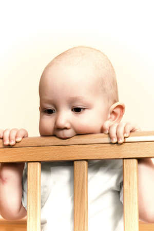 The child waits mum in cot Stock Photo - 6635696