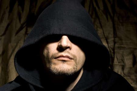 hooded sweatshirt: Portrait of the young man in hood Stock Photo