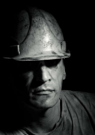 COAL MINER: Portrait of the worker on a black background