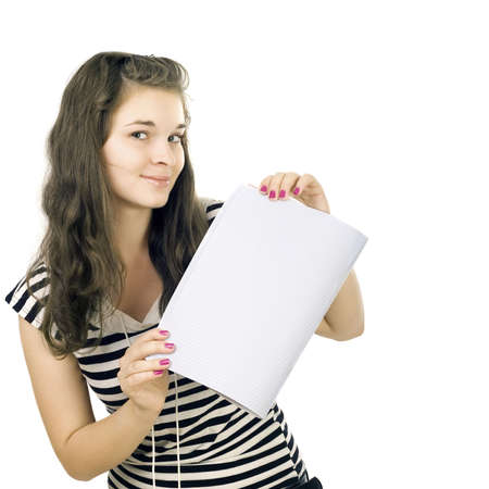 The schoolgirl has control over an open writing-book. Isolated white background
