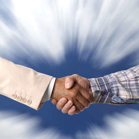 men shaking hands: Handshake against the blue sky