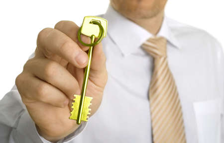 Handing over the key. Close-up Stock Photo - 7243943