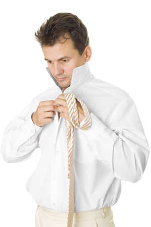 The businessman puts on a shirt and a tie. The isolated white background Stock Photo - 7304771