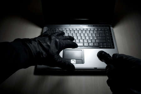 identity thieves: The hacker tries to crack system on the laptop
