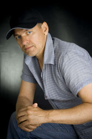 Portrait of the person in a cap on a black background Stock Photo - 7400067