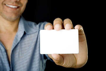 Blank business card in a hand photo