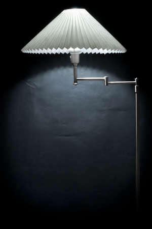 fixture: Electric lamp against a black wall