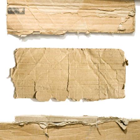 cardboard: Pi�ces en carton sur le fond blanc isol�