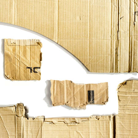 Cardboard pieces on the isolated white background photo