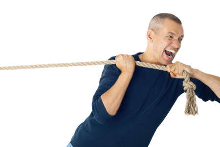 persistence: Man pulls a rope. Isolated white background