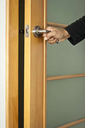 door knob: The person opens an interroom door