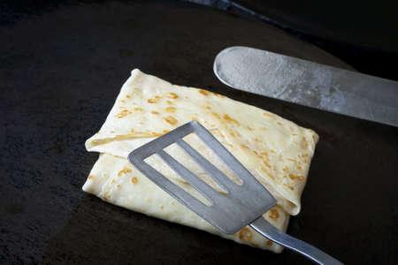 overturn: Making pancakes. Shovels overturn a pancake
