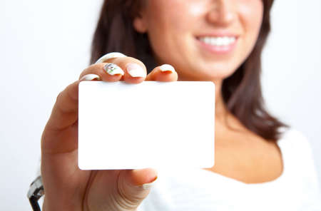 businesscard: The young woman holds businesscard in a hand