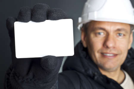 Blank business card in a hand Stock Photo - 8404730