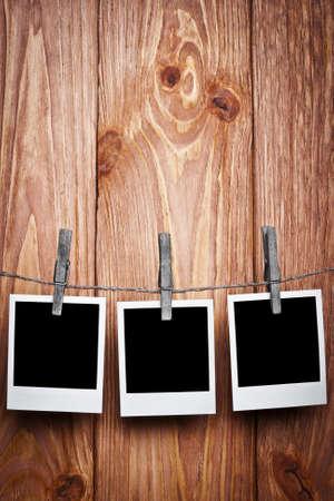 Three Polaroids on a wooden background photo