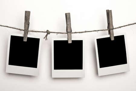 white polaroids: Three Polaroids on a white background Stock Photo