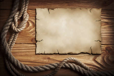 Ropes, old paper on a wooden background Stock Photo - 8809732