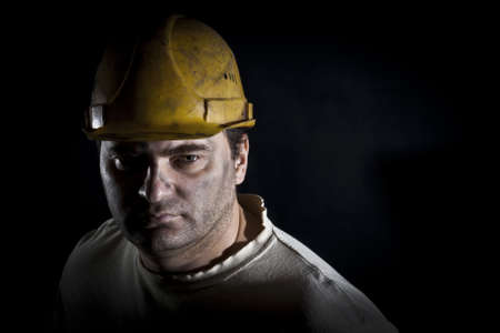 Portrait of the worker on a black background