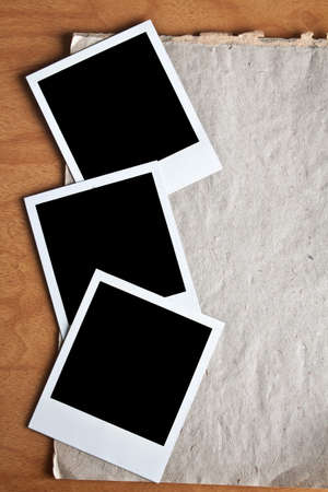 Three Polaroids on a surface of an old paper
