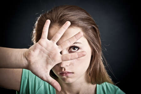 violate: Portrait of the young woman. The person is closed by a hand