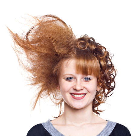 Portrait of the young woman. Strange hairdress. Charming smile