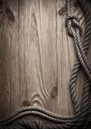 rope background: Ropes on a wooden background