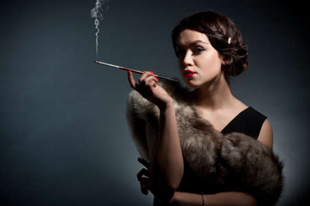 black girl smoking: Portrait of the young woman in style of a retro against a dark background